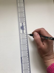 Draw a horizontal and vertical line across the centre of your target sketch paper