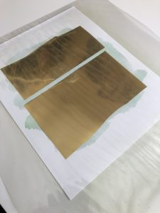 How to make a gold foil print - cut the foil to size and place it on your print. Then I use a transfer folder with my minc.